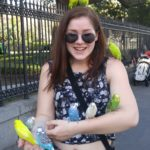 Playing with parakeets at Jackson Square.